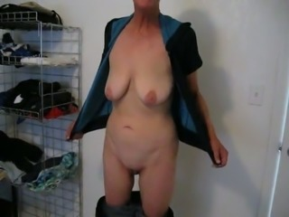 Bald granny stripping in front of camera showing saggy boobs