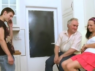 Horny old fart stuffs mouth of a young babe with his penis