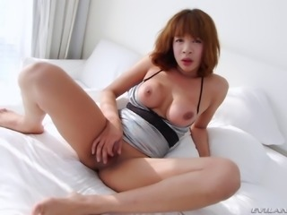 Ya is a hot Asian shemale who likes showing off her body