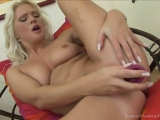 Desirable blonde with big tits enjoys masturbating