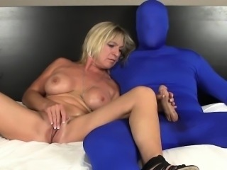 Busty mature amateur wanks guy in morphsuit