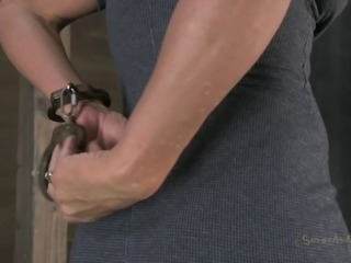 Blonde bondage slave with big tits licking balls in BDSM