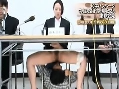 News reporter gets licked under the desk and gives a blowjo