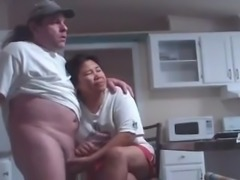 Guy cums on mature Asian wife