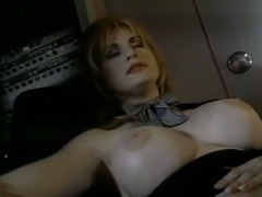 Blonde bimbo with fake big breasts gives amazing head