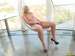 Blonde Kimmy Olsen with big ass and