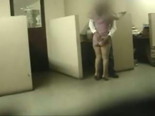 Amateur couple banging in an office get caught on a hidden cam