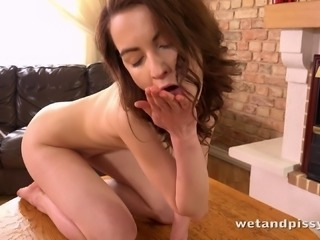 Skinny redhead solo model fingering her shaved pussy in close up