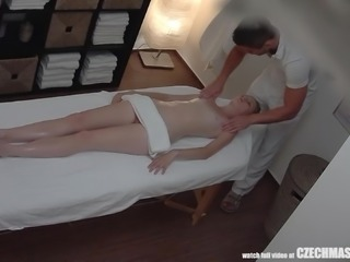 She got much more than a massage today. She went in for a rub down, but this sexy redheaded beauty ended up getting fucked really hard by the masseur. He rammed his stiff penis in her wet pussy, and he slid across her oiled body.