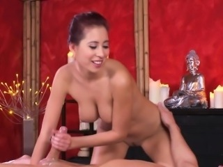 Busty Asian masseuse giving orgasmic handjob