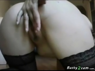 Woman shows her pussy and big tits in doggy style