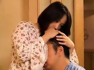 Big breasted Japanese wife with a marvelous ass pleases a h