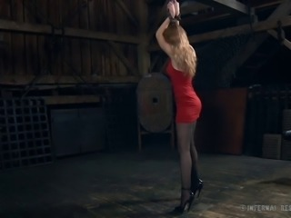 Stunning slave woman dolled up for a magical BDSM game