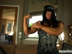 Beefy Milf shows us her muscles then her big clit and dildos