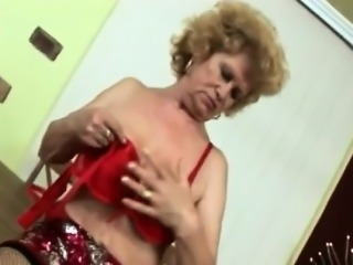 Busty blonde granny takes younger boner on table