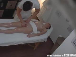 The camera caught some sexy hidden action in the massage parlor. She thought she was just going to get a regular massage, but she ended up having her pussy played with. The masseur rubbed her sensually, then he brought his fingers up to her twat, and played with her clit.