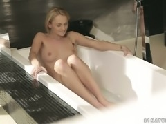 Sweet lean petite blondie in the bathtub playing with herself solo
