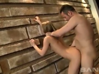 Blond haired petite cutie Kate Gross gets doggy fucked by the wall tough