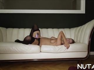 Red hawt attractive babe sticks toy in pussy