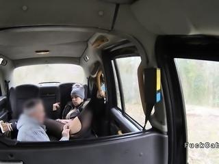 Blonde in cap bangs in pantyhose in fake cab