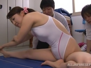 Two dudes are impressed with the abilities of a Japanese gymnast