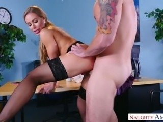 Nicole Aniston is having some steamy sex in the lecture room