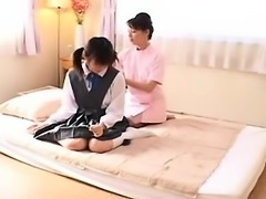 Pigtailed Japanese cutie has a masseuse devouring her hot h