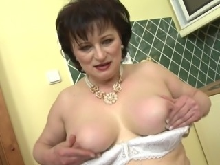 mature woman with natural boobs rubs her pussy