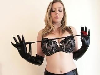 Kinky blonde in latex masturbates wearing gloves