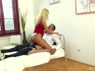 Blonde magnificent lady in red dress seduces and fucks a doctor