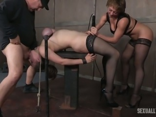 Beautiful and busty white chick in black stockings restrained and facefucked