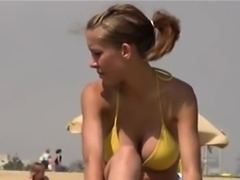 Woman Shot on Camera Performing Nude in the Seaside