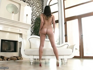 Brunette is full of passion to fuck herself with dildo