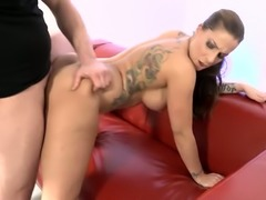 Tattooed busty MILF in fancy high knee boots gets her twat stretched in...