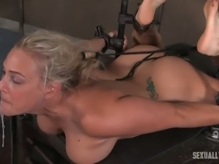 Busty and cute blonde babe shackled and facefucked hardcore on the table