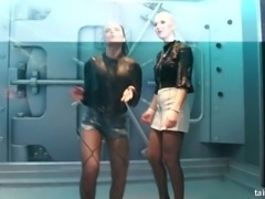 Adorable white bitches in clothes stand under the shower and dance