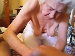 Granny massages a dick