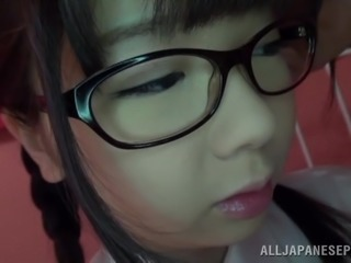 Japanese teen in glasses gives a titjob and rides a cock in POV video