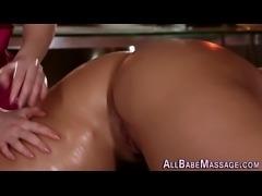 Masseuse strokes pussy