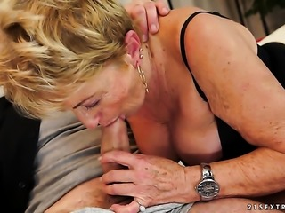 Blonde with massive breasts lets man put