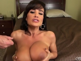 Huge boobed MILF Lisa Ann gets nailed from behind and a load on her tits