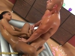 Magnificent ebony masseuse oils up and rides big white cock of her client