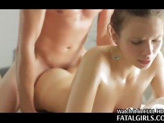 Her beautiful body is first coated with oil and then she takes a cock in her...