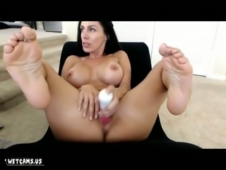 This huge breasted MILF looks even hotter with a sex toy in her snatch