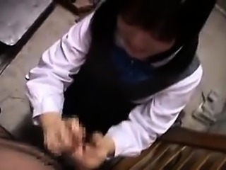 Pretty Oriental schoolgirl puts her hands and lips to work
