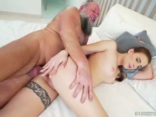 Wicked pale skin redhead chick feels horny for big bearded old man on the bed