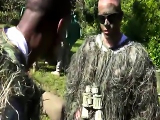 Gay soldiers having blowjob exercise outdoors