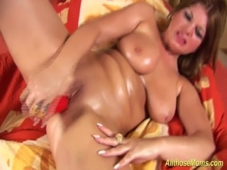 extreme horny chubby Milf plays with her oiled big natural monster boobs