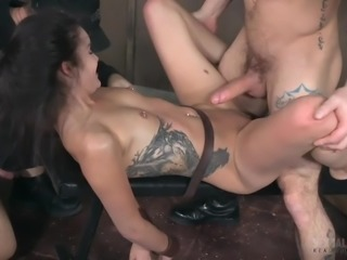 She is sexually broken and used as a sexual plaything by her two horny and dominant masters. They fuck her hard from both ends and she takes it like a slave is supposed to. One dude pile drives her wet pussy, while the other stud face fucks her. This is what she gets when she is bound.