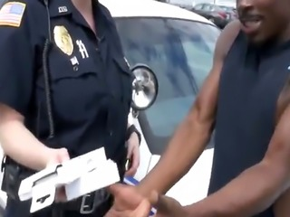 Arrested black stud gets cock pleased by policewomen